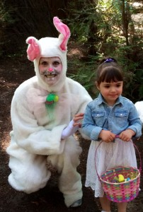 Denise the Easter Bunny with a little girl Easter egg hunting
