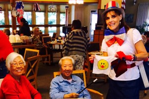 Denise visited a local retirement home dressed as a clown (minus the face paint), doing magic tricks.