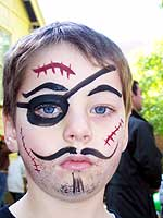 A boy with a pirate face painting by Denise Dutil - Entertainer for Kids
