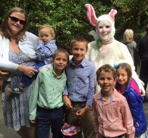 Denise the Easter Bunny with a happy family at an Easter party