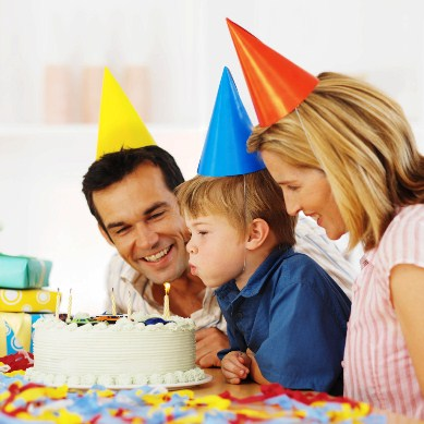 Parents celebrating son's (5-6) birthday --- Image by © Royalty-Free/Corbis