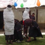 Two people being wrapped liked a mummy as a party game