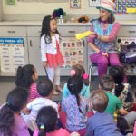 Denise interacts with the kids during her Magic Comedy Show at a preschool birthday party.