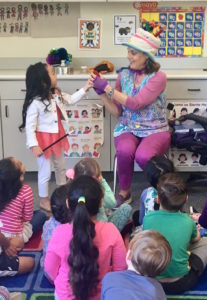 Kid's entertainer Denise encourages children to participate during her Magic Comedy Show at a preschool birthday party.