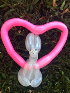 balloons twisted into the shape of a bunny in a heart