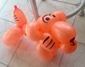 orange balloons twisted into the shape of a tiger